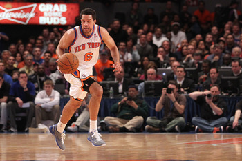 NEW YORK, NY - APRIL 22:  Landry Fields #6 of the New York Knicks brings the ball up court against the Boston Celtics in Game Three of the Eastern Conference Quarterfinals in the 2011 NBA Playoffs on April 22, 2011 at Madison Square Garden in New York Cit