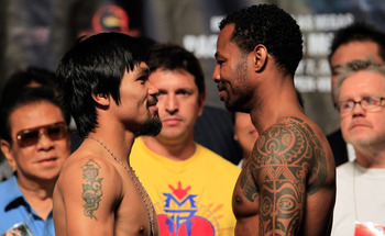 LAS VEGAS, NV - MAY 06:  (L-R) Boxers Manny Pacquiao of the Philippines and Shane Mosley pose after the weigh-in for their WBO welterweight title fight at MGM Grand Garden Arena on May 6, 2011 in Las Vegas, Nevada. Pacquiao will defend his WBO welterweigh