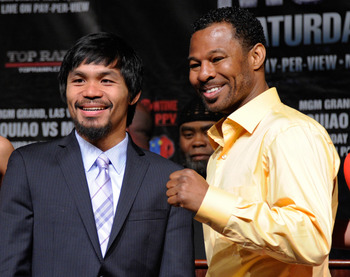 LAS VEGAS, NV - MAY 04:  Boxers Manny Pacquiao (L) and Shane Mosley pose during the final news conference for their bout at the MGM Grand Hotel/Casino May 4, 2011 in Las Vegas, Nevada. Pacquiao will defend his WBO welterweight title against Mosley on May
