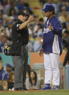 LOS ANGELES - MAY 2:  Manager Don Mattingly of the Los Angeles Dodgers argues with home plate umpire Jerry Meals during the game with the Chicago Cubs  on May 2, 2011 at Dodger Stadium in Los Angeles, California.  (Photo by Stephen Dunn/Getty Images)