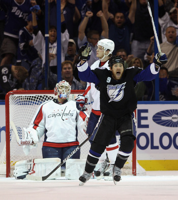 TAMPA, FL - MAY 04:  Steve Downie #9 of the Tampa Bay Lightning celebrates the game winning goal by Marc-Andre Bergeron #47 at 5:07 of the third period against the Washington Capitals  in Game Four of the Eastern Conference Semifinals during the 2011 NHL