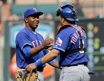 BALTIMORE, MD - APRIL 10:  Relief pitcher Neftali Feliz #30 of the Texas Rangers is congratulated by catcher Yorvit Torrealba #8 after the Rangers defeated the Baltimore Orioles 3-0 at Oriole Park at Camden Yards on April 10, 2011 in Baltimore, Maryland.