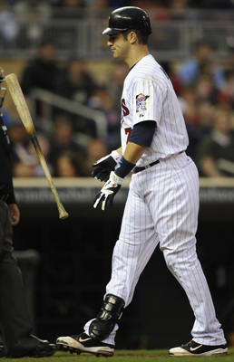 MINNEAPOLIS, MN - APRIL 9: Joe Mauer #7 of the Minnesota Twins reacts after a called strike three in the fifth inning against the Oakland Athletics on April 9, 2011 at Target Field in Minneapolis, Minnesota. Athletics defeated the Twins 1-0. (Photo by Han