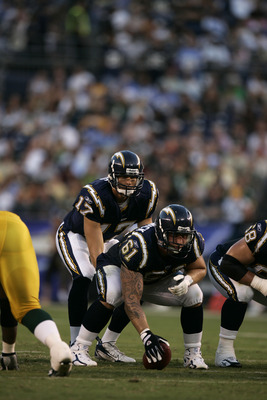 SAN DIEGO - AUGUST 12:  Quarterback Philip Rivers #17 of the San Diego Chargers waits for the snap from center Nick Hardwick #61 during the preseason game against the Green Bay Packers on August 12, 2006 at Qualcomm Stadium in San Diego, California. The C