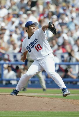 LOS ANGELES - APRIL 5:  Pitcher Hideo Nomo #10 of the Los Angeles Dodgers winds back to pitch during the game against the San Diego Padres on April 5, 2004 at Dodger Stadium in Los Angeles, California. The Padres defeated the Dodgers 8-2 in the season ope