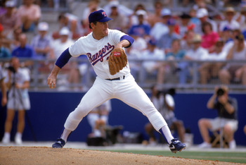 ARLINGTON, TX - 1990s:  Nolan Ryan #34 of the Texas Rangers pitches during a circa 1990s game at Arlington Stadium in Arlington, Texas. Ryan pitched for the Rangers from 1989-93.  (Photo by Jonathan Daniel/Getty Images)