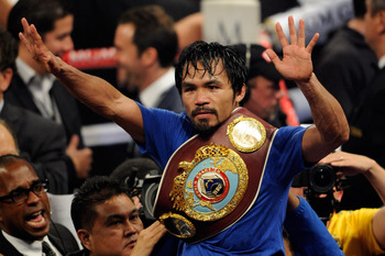 LAS VEGAS, NV - MAY 07:  Manny Pacquiao (R) throws a right at Shane Mosley in the sixth round of their WBO welterweight title fight at the MGM Grand Garden Arena May 7, 2011 in Las Vegas, Nevada. Pacquiao retained his title with a unanimous-decision victo