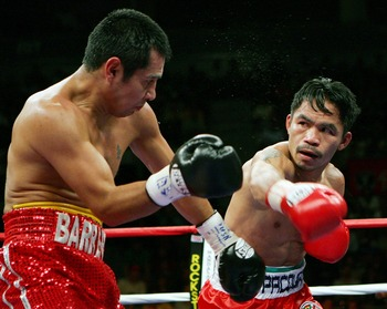 LAS VEGAS - OCTOBER 06:  Marco Antonio Barrera (L) and Manny Pacquiao trade punches in the fifth round of their 12-round super featherweight bout at the Mandalay Bay Events Center October 6, 2007 in Las Vegas, Nevada. Pacquiao won by unanimous decision.