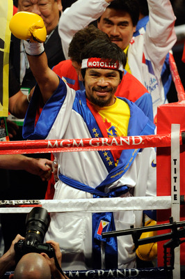 LAS VEGAS, NV - MAY 07:  Manny Pacquiao of the Philippines greets the crowd before taking on Shane Mosley in the WBO welterweight title fight at MGM Grand Garden Arena on May 7, 2011 in Las Vegas, Nevada.  (Photo by Ethan Miller/Getty Images)