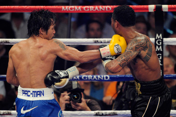 LAS VEGAS, NV - MAY 07:  (L-R) Manny Pacquiao of the Philippines throws a right at Shane Mosley in the WBO welterweight title fight at MGM Grand Garden Arena on May 7, 2011 in Las Vegas, Nevada.  (Photo by Ethan Miller/Getty Images)