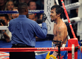 LAS VEGAS, NV - MAY 07:  Referee Kenny Bayless counts after Manny Pacquiao of the Philippines is knocked down in the 10th round by Shane Mosley in the WBO welterweight title fight at MGM Grand Garden Arena on May 7, 2011 in Las Vegas, Nevada.  (Photo by E
