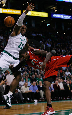 BOSTON - JANUARY 11:  Glen Davis #11 of the Boston Celtics is called for a flagrant foul on Marvin Williams #24 of the Atlanta Hawks at the TD Garden on January 11, 2010 in Boston, Massachusetts. The Hawks defeated the Celtics 102-96. NOTE TO USER: User e