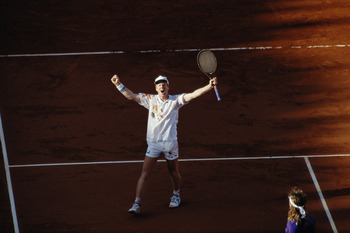 Jim Courier celebrates his defeat of Andre Agassi 3-6 6-4 2-6 6-1 6-4 in the final to win the Men's Singles title at the French Open on 9th June 1991at the Roland Garros stadium in Paris, France. (Photo by Pascal Rondeau/Getty Images)
