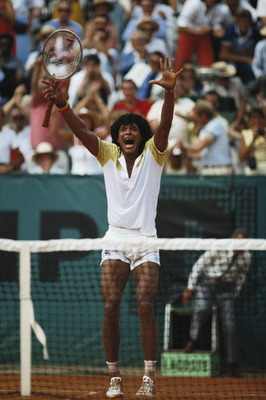 Yannick Noah of France raises his arms in celebration after defeating Mats Wilander in the Men's Singles final match during the French Open Tennis Championship on 5th June 1983 at the Stade Roland Garros Stadium in Paris, France. (Photo by Steve Powell/Ge