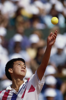 Michael Chang of the United States keeps his eyes on the ball as he prepares to serve to Stefan Edberg during the Men's Singles final match at the French Open Tennis Championship on 11th  June 1989 at the Stade Roland Garros Stadium in Paris, France.(Phot