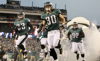 PHILADELPHIA, PA - JANUARY 02:  Dimitri Patterson #23, Colt Anderson #30, and Mike Patterson #98 of the Philadelphia Eagles take the field to play against the Dallas Cowboys on January 2, 2011 at Lincoln Financial Field in Philadelphia, Pennsylvania.  (Ph