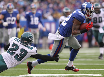 EAST RUTHERFORD, NJ - DECEMBER 19:  Mario Manningham #82 of the New York Giants turns out of the tackle of Dimitri Patterson #23 of the Philadelphia Eagles on his way to a touchdown at New Meadowlands Stadium on December 19, 2010 in East Rutherford, New J