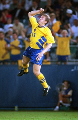 24 JUN 1994:  THOMAS BROLIN OF SWEDEN LEAPS FOR JOY AFTER SCORING AGAINST RUSSIA DURING THE  1994 WORLD CUP AT THE SILVERDOME IN PONTIAC, MICHIGAN.  THE FIRST-HALF GOAL TIED THE GAME AT 1-1. Mandatory Credit: JONATHAN DANIEL/ALLSPORT