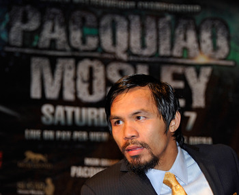 LAS VEGAS, NV - MAY 07:  Boxer Manny Pacquiao listens to a question at a post-fight news conference after he defeated Shane Mosley by unanimous decision to retain his WBO welterweight title at the MGM Grand Garden Arena May 7, 2011 in Las Vegas, Nevada.