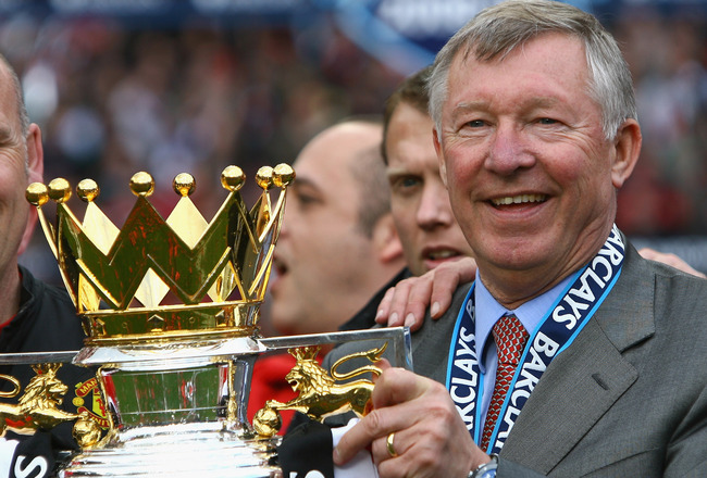 MANCHESTER, ENGLAND - MAY 16:  Manchester United Manager Sir Alex Ferguson celebrates with the Barclays Premier League trophy after his side won the Premier League title at the end of the Barclays Premier League match between Manchester United and Arsenal