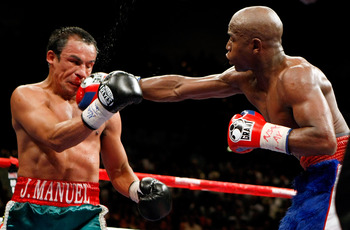 LAS VEGAS - SEPTEMBER 19:  Floyd Mayweather Jr. (R) hits Juan Manuel Marquez in the eighth round of their fight at the MGM Grand Garden Arena September 19, 2009 in Las Vegas, Nevada. Mayweather won by unanimous decision.  (Photo by Ethan Miller/Getty Imag