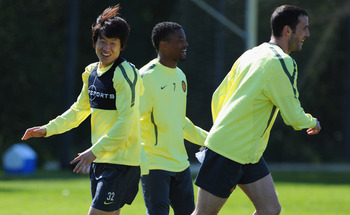 MANCHESTER, ENGLAND - MAY 03: Park Ji-Sung, Patrice Evra and John O'Shea look on during a training session ahead of their UEFA Champions League semi final second leg match against Schalke 04 at the Carrington Training Ground on May 3, 2011 in Manchester,