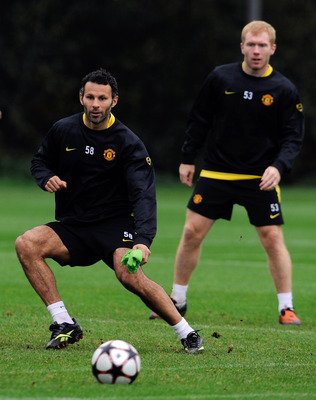 MANCHESTER, ENGLAND - SEPTEMBER 29: Ryan Giggs and Paul Scholes warm up during a Manchester United training session at the Carrington Training Complex  ahead of their UEFA Champions league group B match against Wolfsburg  on September 29, 2009 in Manchest