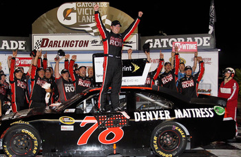 DARLINGTON, SC - MAY 07:  Regan Smith, driver of the #78 Furniture Row Companies Chevrolet, celebrates in Victory Lane after winning the NASCAR Sprint Cup Series SHOWTIME Southern 500 at Darlington Raceway on May 7, 2011 in Darlington, South Carolina.  (P