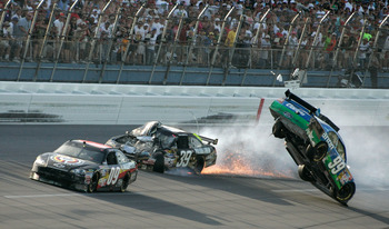 TALLADEGA, AL - APRIL 26:  Carl Edwards, driver of the #99 Claritin Ford, goes airborne as Ryan Newman, driver of the #39 Steweart-Haas Racing Chevrolet suffers damage and Brad Keselowski, driver of the #09 Miccosukee Indian Gaming Chevrolet drives at the