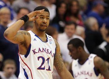 LAWRENCE, KS - FEBRUARY 12:  Markieff Morris #21 of the Kansas Jayhawks slautes the crowd during the game against the Iowa State Cyclones on February 12, 2011 at Allen Fieldhouse in Lawrence, Kansas.  (Photo by Jamie Squire/Getty Images)