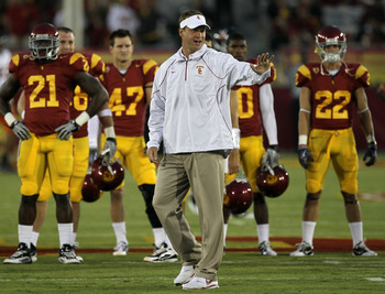 LOS ANGELES, CA - SEPTEMBER 11:  Head coach Lane Kiffin gestures as the USC Trojans warm up for their game with the Virginia Cavaliers at Los Angeles Memorial Coliseum on September 11, 2010 in Los Angeles, California.  (Photo by Stephen Dunn/Getty Images)