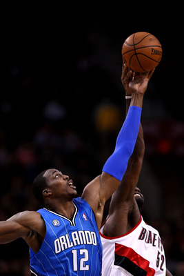 PORTLAND, OR - DECEMBER 09:  Dwight Howard #12 of the Orlando Magic battles Greg Oden #52 of the Portland Trail Blazers forthe opening tip at the Rose Garden on December 9, 2008 in Portland, Oregon.  NOTE TO USER: User expressly acknowledges and agrees th