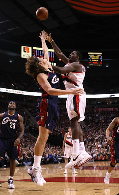 PORTLAND, OR - JANUARY 21:  Greg Oden #52 of the Portland Trail Blazers lays up the ball against Anderson Varejao #17 of the Cleveland Cavaliers at the Rose Garden on January 21, 2009 in Portland, Oregon.  NOTE TO USER: User expressly acknowledges and agr