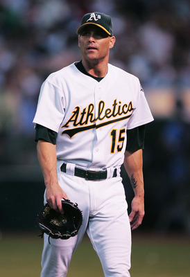 OAKLAND, CA - SEPTEMBER 8:  Tim Hudson #15 of the Oakland Athletics walks off the mound after the first inning against the Boston Red Sox during a MLB game at the Network Associates Coliseum on September 8, 2004 in Oakland, California. (Photo by Jed Jacob