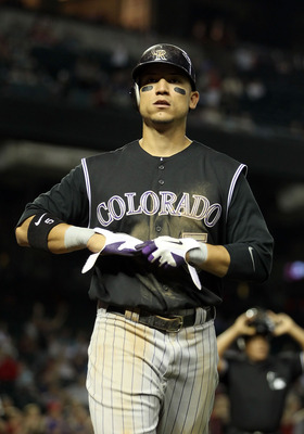 PHOENIX, AZ - MAY 03:  Carlos Gonzalez #5 of the Colorado Rockies walks to the duogut during the Major League Baseball game against the Arizona Diamondbacks at Chase Field on May 3, 2011 in Phoenix, Arizona.  The Diamondbacks defeated the Rockies 4-3.  (P