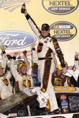 TALLADEGA, AL - OCTOBER 2:  Dale Jarrett, driver of the #88 UPS Ford, celebrates winning the NASCAR Nextel Cup Series UAW-Ford 500 on October 2, 2005 at the Talladega Superspeedway in Talladega, Alabama.  (Photo by Rusty Jarrett/Getty Images)