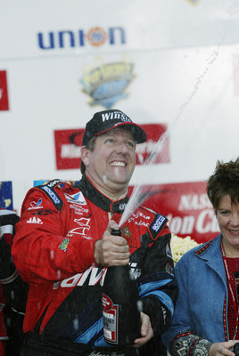ROCKINGHAM, NC - NOVEMBER 3:  Johnny Benson #10, driver of the Valvoline Pontiac, celebrates winning the Pop Secret Microwave Popcorn 400 on November 3, 2002 at North Carolina Speedway in Rockingham, North Carolina.   (Photo by Craig Jones/Getty Images)