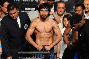 LAS VEGAS, NV - MAY 06:  Boxer Manny Pacquiao of the Philippines steps on the scale at 145 pounds before his WBO welterweight title fight against Shane Mosley at MGM Grand Garden Arena on May 6, 2011 in Las Vegas, Nevada. Pacquiao will defend his WBO welt
