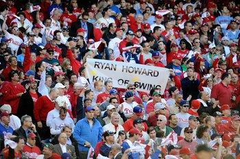 PHILADELPHIA - OCTOBER 08:  Fans of the Philadelphia Phillies hold up a sign which reads 'Ryan Howard King of Swing' against the Colorado Rockies in Game Two of the NLDS during the 2009 MLB Playoffs at Citizens Bank Park on October 8, 2009 in Philadelphia