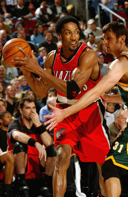 SEATTLE - MARCH 11:  Scottie Pippen #33 of the Portland Trail Blazers looks to pass around Brent Barry #31 of the Seattle Sonics during the game at Key Arena on March 11, 2003 in Seattle, Washington.  The Trail Blazers won 92-77.  NOTE TO USER: User expre