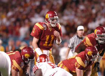 USC quarterback Matt Leinart gets behind the center during the FedEx Orange Bowl National Championship at Pro Player Stadium in Miami, Florida on January 4, 2005. USC beat Oklahoma 55-19. (Photo by A. Messerschmidt/Getty Images)