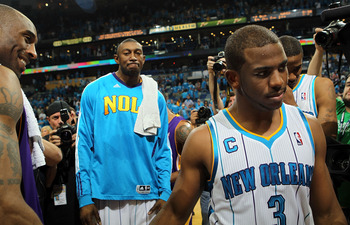 NEW ORLEANS, LA - APRIL 28:  Chris Paul #3 of the New Orleans Hornets walks off the court after a 98-80 loss as Kobe Bryant #24 of the Los Angeles Lakers smiles after winning the series in Game Six of the Western Conference Quarterfinals in the 2011 NBA P