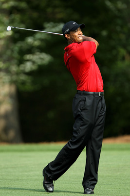 AUGUSTA, GA - APRIL 10:  Tiger Woods hits his second shot on the 11th hole during the final round of the 2011 Masters Tournament at Augusta National Golf Club on April 10, 2011 in Augusta, Georgia.  (Photo by Jamie Squire/Getty Images)