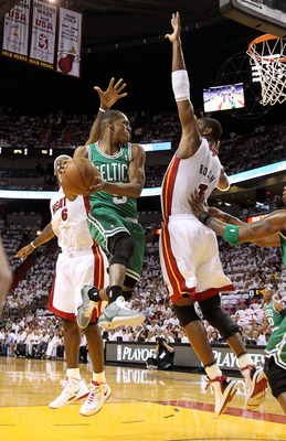 MIAMI, FL - MAY 03:  Rajon Rondo #9 of the Boston Celtics takes a shot against Chris Bosh #1 and LeBron James #6 of  the Miami Heat during Game Two of the Eastern Conference Semifinals of the 2011 NBA Playoffs at American Airlines Arena on May 3, 2011 in