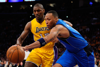 LOS ANGELES, CA - MAY 02:  Shawn Marion #0 of the Dallas Mavericks and Ron Artest #15 of the Los Angeles Lakers go after a loose ball in the second half in Game One of the Western Conference Semifinals in the 2011 NBA Playoffs at Staples Center on May 2,