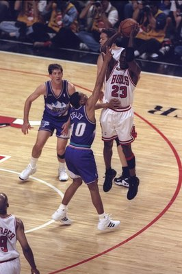 10 Jun 1998:  Michael Jordan #23 of the Chicago Bulls in action against Howard Eisley and Jeff Hornasek of the Utah Jazz during the NBA Finals Game 4 at the United Center in Chicago, Illinois.  The Bulls defeated the Jazz 86-82. Mandatory Credit: Jonathan