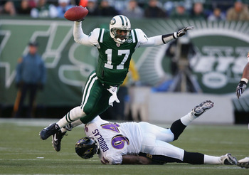 EAST RUTHERFORD, NJ - NOVEMBER 14:  Quincy Carter #17 of the New York Jets is sacked by Marques Douglas #94 of the Baltimore Ravens November 14, 2004 at Giants Stadium in East Rutherford, New Jersey.  (Photo by Al Bello/Getty Images)