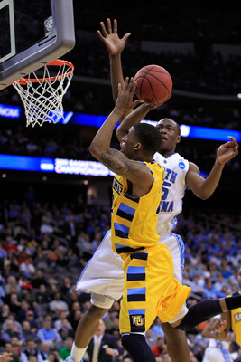 NEWARK, NJ - MARCH 25:  Vander Blue #2 of the Marquette Golden Eagles in action against Justin Knox #25 of the North Carolina Tar Heels during the east regional semifinal of the 2011 NCAA Men's Basketball Tournament at the Prudential Center on March 25, 2