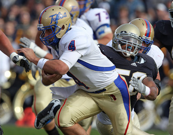 SOUTH BEND, IN - OCTOBER 30: G.J. Kinne #4 of the Tulsa Golden Hurricane is tackled by Brian Smith #58 of the Notre Dame Fighting Irish rushes at Notre Dame Stadium on October 30, 2010 in South Bend, Indiana. Tulsa defeated Notre Dame 28-27. (Photo by Jon