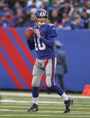 EAST RUTHERFORD, NJ - DECEMBER 19:  Eli Manning #10 of the New York Giants in action against the Philadelphia Eagles 38-31  on December 19, 2010 at The New Meadowlands Stadium in East Rutherford, New Jersey.  (Photo by Al Bello/Getty Images)